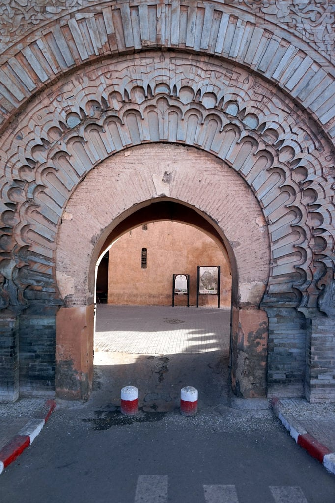 Image of Bab Agnaou. marrakech morroco arab northafrica sun outdoors sky clouds city buildings old historic babagnaou gate walls decorative