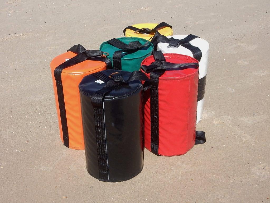 Image of Grange Beach near Grange. coloured colored various beach grange bags floats