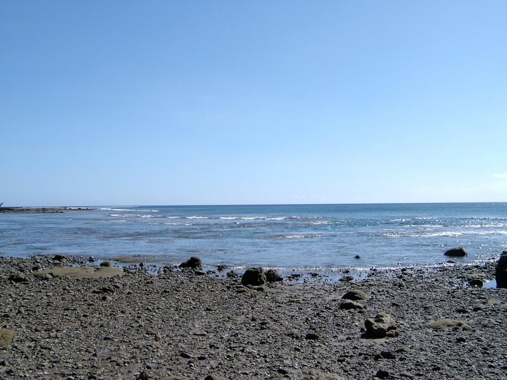 Изображение на Abong Beach. panorama bay sella guam umatac