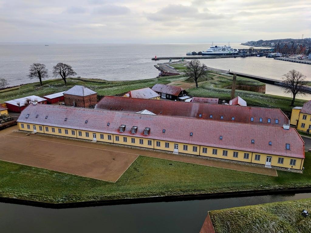 Image of Kronborg Castle. building long barracks helsingør ferry snow roof moat kronborg kronborgcastle elsinore orthographic