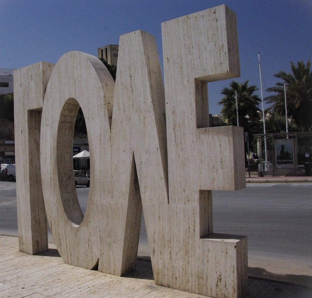 Immagine di LOVE. old sculpture building art love monument public rock stone architecture text letters malta inverted 2011