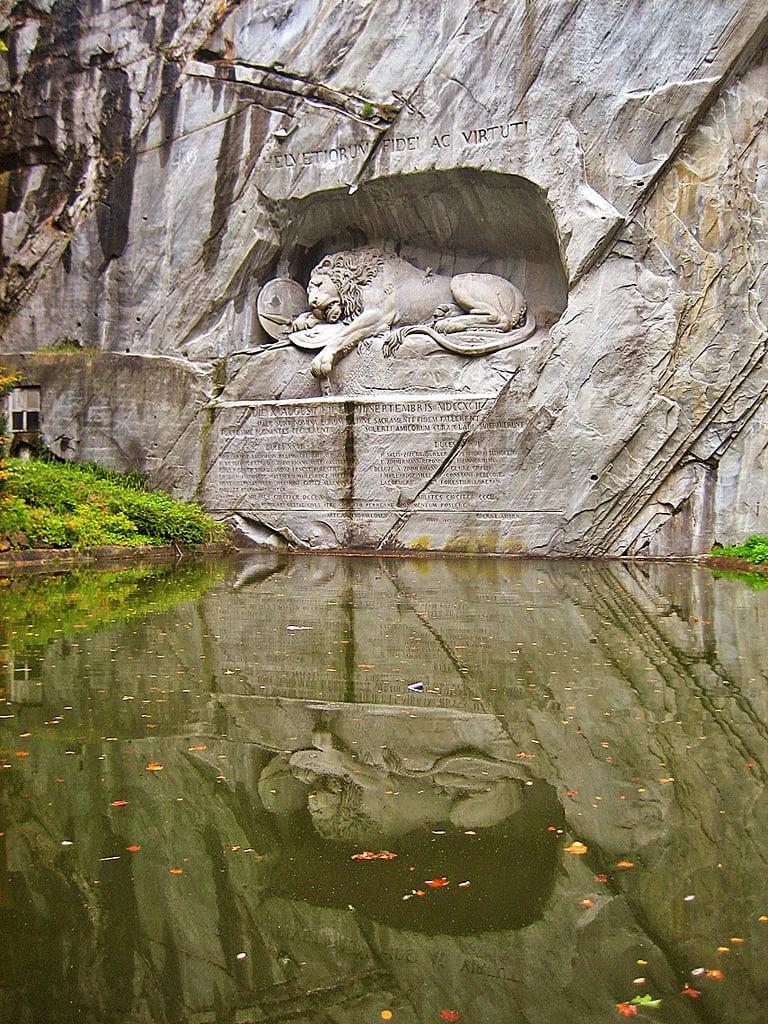 Image of Lion Monument. city sculpture luzern marktwain switserland swissguards zwitserland löwendenkmal lionmonument swisslion melindavandenbrink